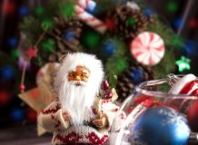 Santa Claus and Christmas tree toys in a round glass vase Stock Image