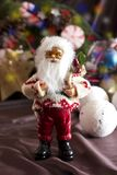 Santa Claus and Christmas tree toys in a round glass vase Royalty Free Stock Photos