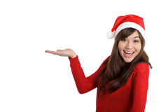 Santa Claus Christmas Woman holding product. On white background royalty free stock photo