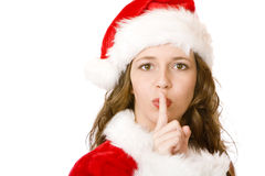 Santa Claus Christmas Woman puts finger on lips Royalty Free Stock Photo