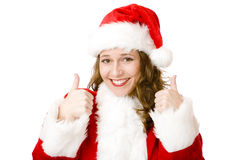 Santa Claus Christmas woman shows thumbs up. Happy Santa Woman is showing thumbs up sign. Isolated on white Royalty Free Stock Photos