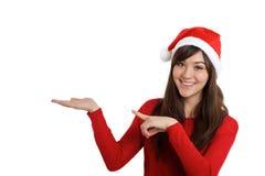 Santa Claus Christmas Woman som pekar produkten Arkivfoton