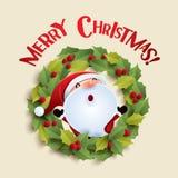 Santa Claus and Christmas wreath Stock Photos