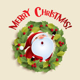 Santa Claus and Christmas wreath Stock Images