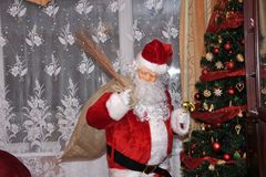Santa Claus and Christmass tree during Xmas with happy girl Stock Photo
