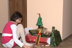 Santa Claus and Christmass tree during Xmas with happy girl. Santa Claus incoming home during holiday Christmass tree during Xmas with happy girl decoration Royalty Free Stock Photo