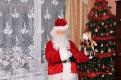 Santa Claus and Christmass tree during Xmas with happy girl. Santa Claus incoming home during holiday Christmass tree during Xmas with happy girl decoration Royalty Free Stock Photography