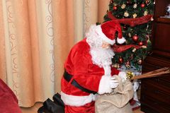Santa Claus and Christmass tree during Xmas with happy girl. Santa Claus incoming home during holiday Christmass tree during Xmas with happy girl decoration Royalty Free Stock Image