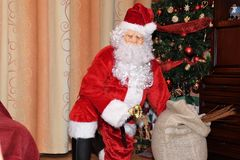 Santa Claus and Christmass tree during Xmas with happy girl Stock Images