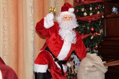 Santa Claus and Christmass tree during Xmas with happy girl. Santa Claus incoming home during holiday Christmass tree during Xmas with happy girl decoration Stock Photography