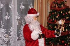 Santa Claus and Christmass tree during Xmas with happy girl. Santa Claus incoming home during holiday Christmass tree during Xmas with happy girl decoration Stock Photo