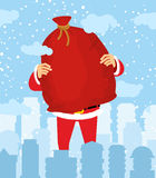 Santa Claus in city carry bag of gifts. Christmas in town. Snow Royalty Free Stock Photo