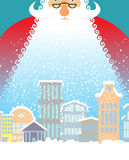 Santa Claus in city. Christmas in town. Snow and buildings. New Royalty Free Stock Image