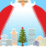 Santa Claus in city. Christmas in town. Snow and buildings. New Royalty Free Stock Photo