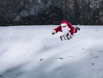 Santa Claus sledging in a snow-covered winter park. Santa Claus royalty free stock images