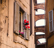 Santa Claus climbing out of the window on the stairs Royalty Free Stock Image