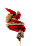 Santa Claus climbing rope. Santa Claus in traditional costume climbing rope; isolated on white background Royalty Free Stock Photo