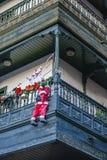 Santa Claus. Climbing up a building Stock Photo