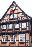 Santa Claus climbing up house Royalty Free Stock Image