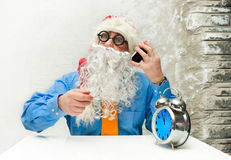 Santa Claus with clock Royalty Free Stock Photography