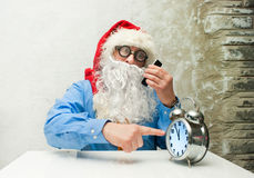 Santa Claus with clock Stock Photography