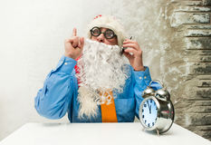 Santa Claus with clock Stock Photos