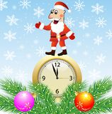Santa claus, clock and green branches with toys Stock Photos