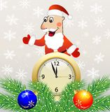 Santa claus, clock and green branches with toys Stock Photo