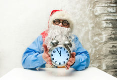 Santa Claus with clock Stock Photo