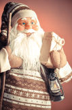 Santa Claus close-up. Santa Claus with a gift and a big smile Royalty Free Stock Photography