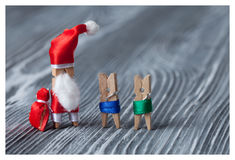 Santa Claus clothespin with kids and gifts. Royalty Free Stock Photography