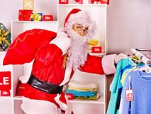 Santa Claus in clothing store. Christmas sale Royalty Free Stock Image
