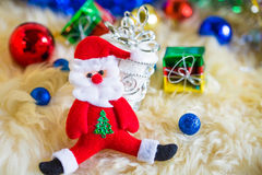 Santa claus with colorful gift and blue green red gold ball decoration on chrismas. T Royalty Free Stock Images