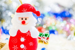 Santa claus with colorful gift and blue green red gold ball decoration on chrismas.  Stock Image
