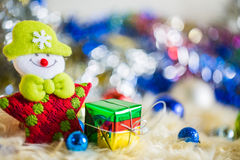 Santa claus with colorful gift and blue green red gold ball decoration on chrismas.  Stock Photography