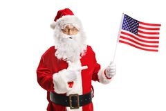Santa Claus com apontar da bandeira americana fotografia de stock royalty free