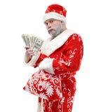 Santa Claus com dólares em um fundo branco imagens de stock royalty free