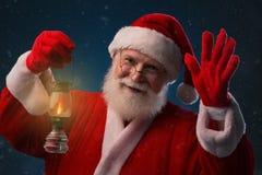 Santa Claus com lanterna Imagens de Stock