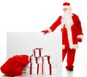 Santa Claus com o saco completo das caixas de presente Fotos de Stock Royalty Free