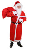 Santa Claus com o saco para os presentes do Natal que mostram os polegares acima Fotos de Stock