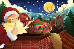 Santa Claus com o trenó completo de presentes de Natal Fotos de Stock