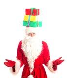 Santa Claus com os presentes em sua cabeça Foto de Stock