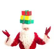 Santa Claus com os presentes em sua cabeça Imagem de Stock