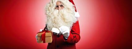 Santa Claus com presentes Imagens de Stock