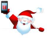 Santa Claus com telefone celular e a bandeira vazia Fotografia de Stock Royalty Free