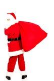 Santa Claus com um saco completo dos presentes Fotografia de Stock