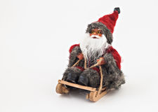 Santa Claus com uma barba em um brinquedo da árvore do trenó isolado Fotografia de Stock
