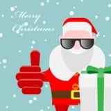 Santa Claus com uma caixa de presente Foto de Stock