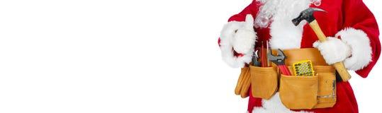 Santa Claus com uma correia da ferramenta Imagens de Stock Royalty Free