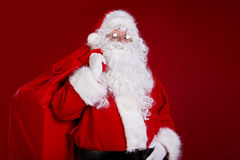 Santa Claus comes with a big bag of gifts. Full length portrait Stock Photography